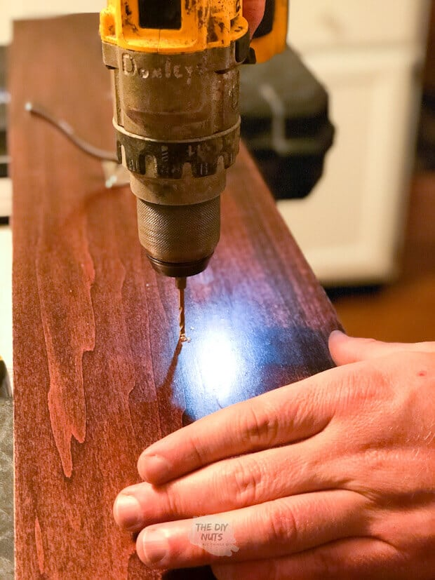 Drilling pilot hole to mount coat rack