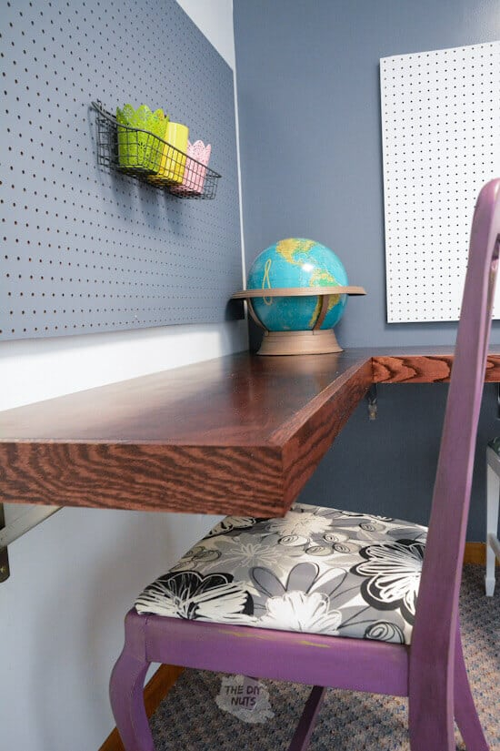 Stained wood floating desk on brackets