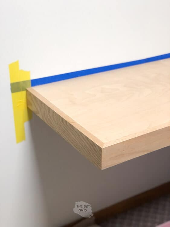 Oak trim used to make finished edge on floating desk