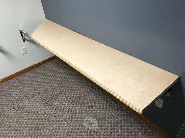 Installing board on desk brackets