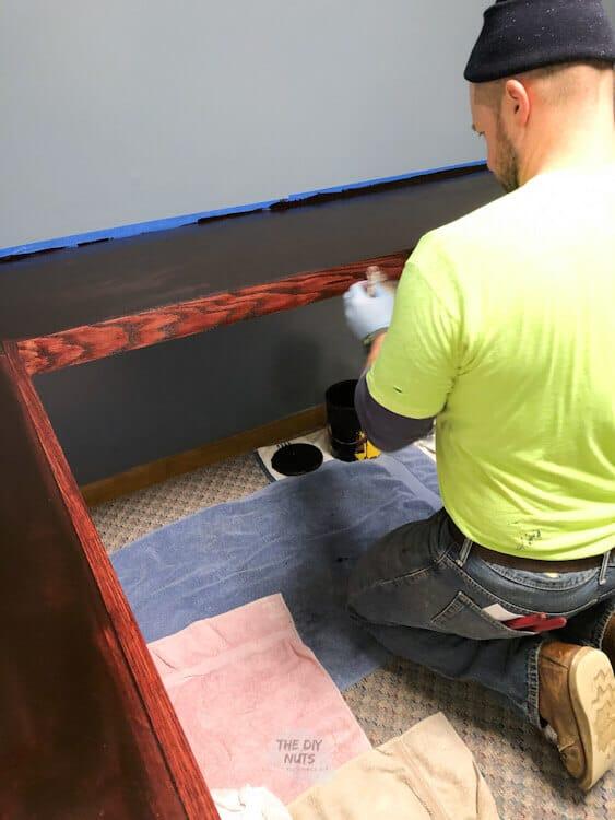 DIY corner floating desk being stained