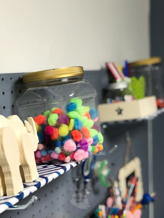 pegboard shelf made from contact paper and cardboard