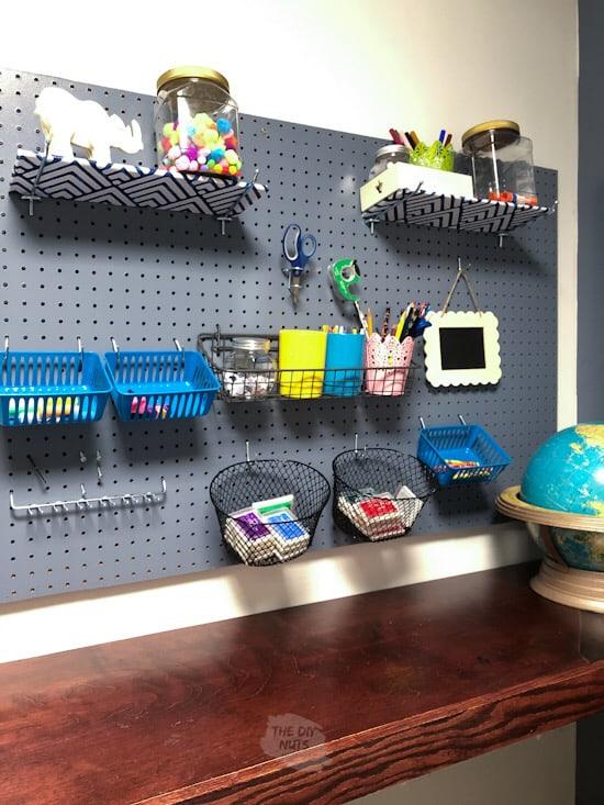 DIY pegboard accessories above craft desk
