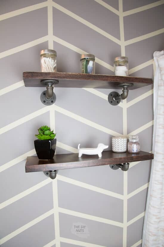 DIY farmhouse industrial shelving above toilet