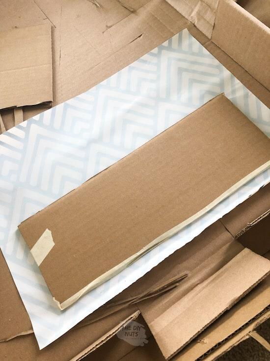 cardboard cut for pegboard shelf