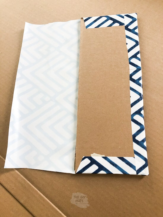 Wrapping pegboard shelf in contact paper