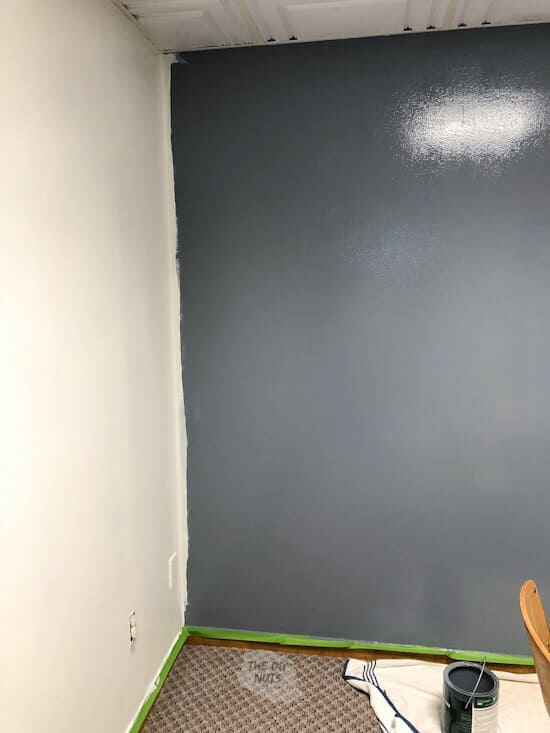 Charcoal blue accent wall in basement room