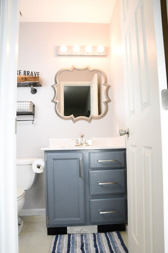 charcoal blue painted bathroom vanity and mirror in bathroom makeover