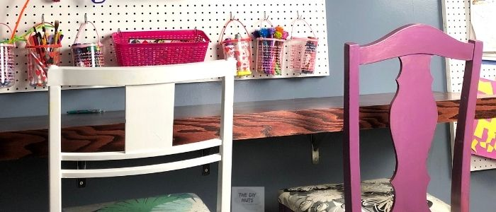 DIY homeschool room with white and purple chairs