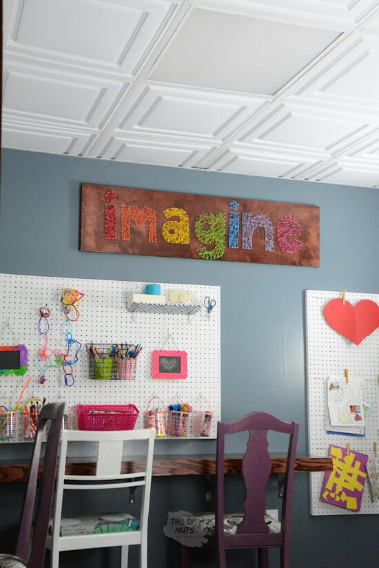 Homeschool room with imagine string art floating desk and pegboard