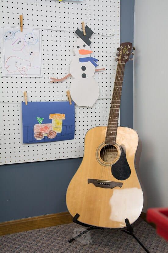 DIY pegboard art display with guitar