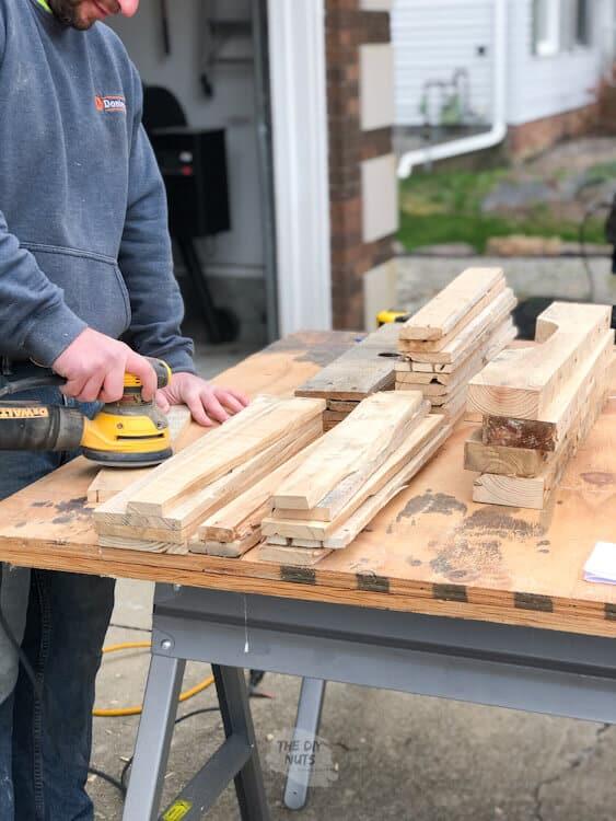 palm sander sanding pallet wood for crate