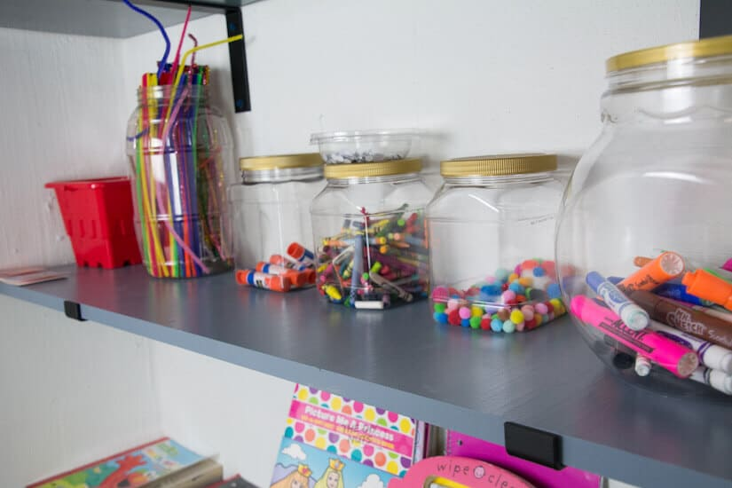 plastic containers to organize kid's craft closet
