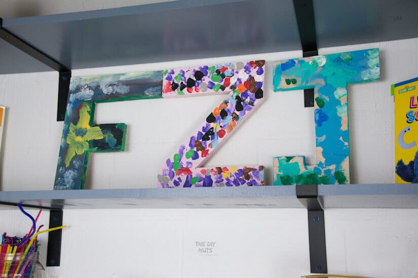 painted wooden letters by children for homeschool room decoration