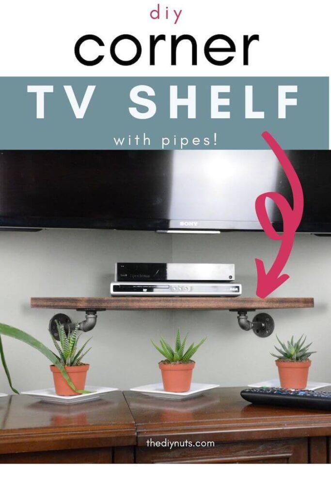 DIY corner tv shelf with wooden corner shelf on pipe flanges under a tv