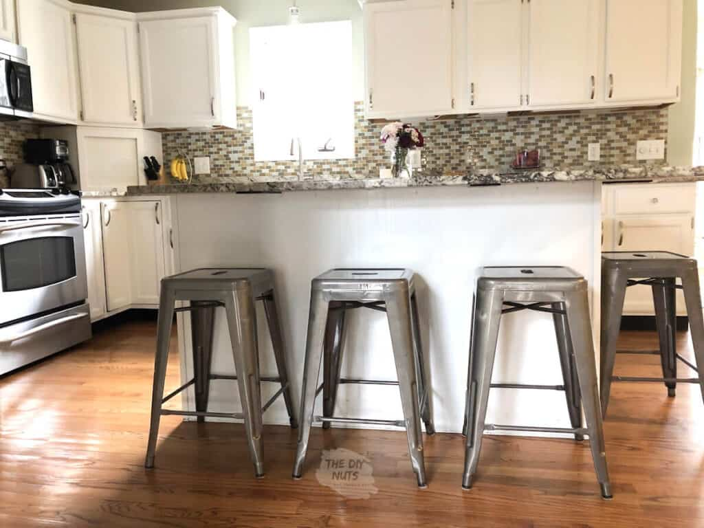 white painted kitchen island with bar stools