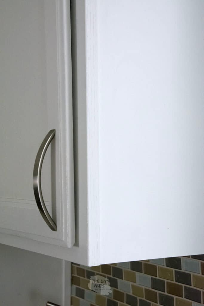 white kitchen painted cabinet with pull