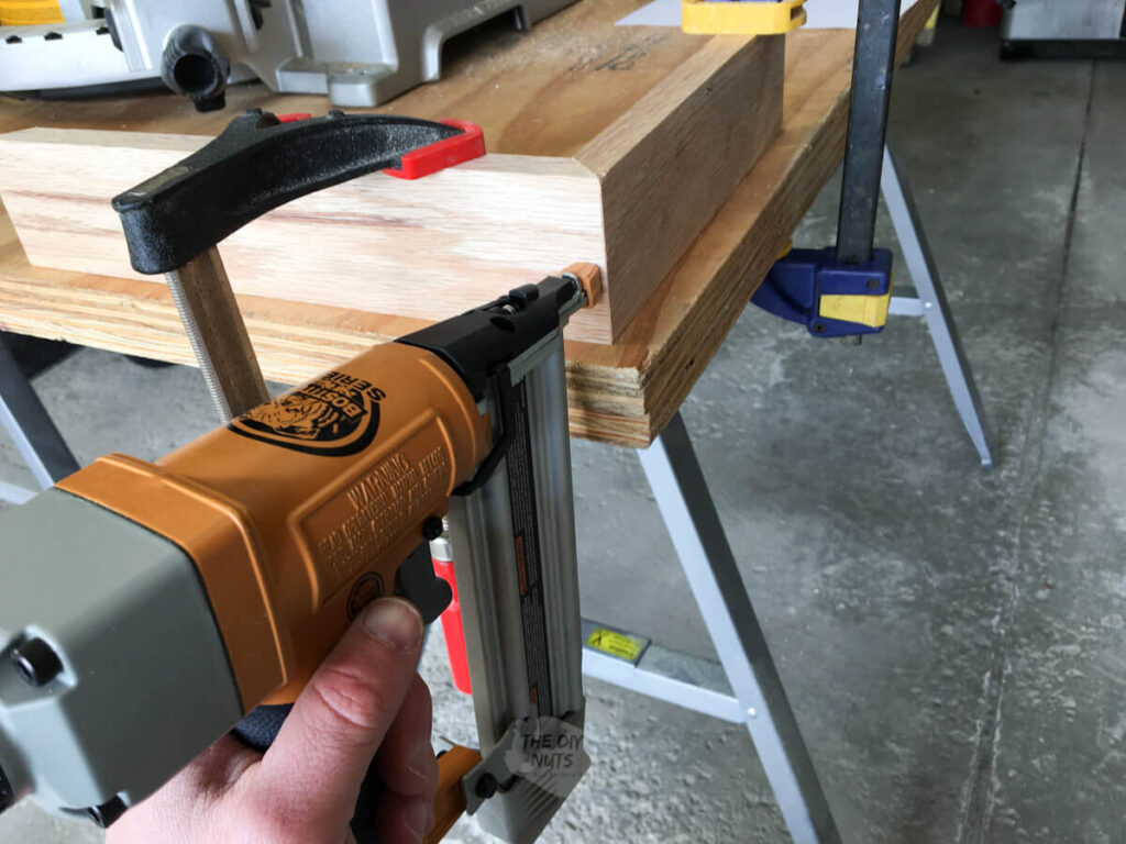 brad nailer being used to put together mitered shadow box