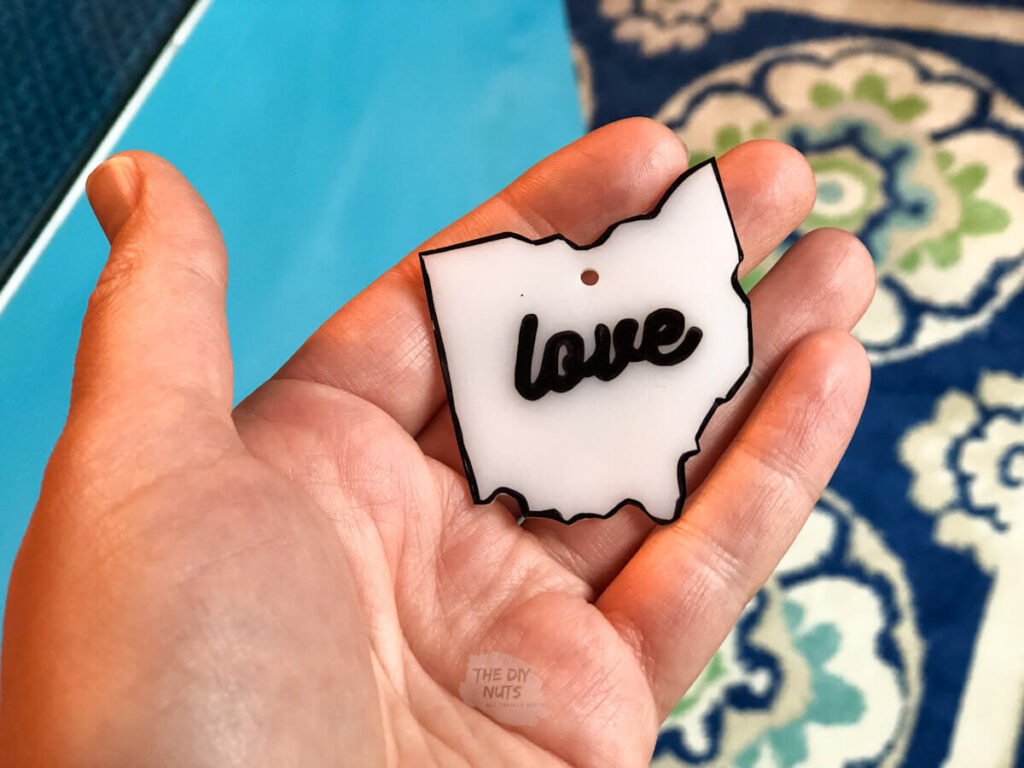 hand holding state shrinky dink idea