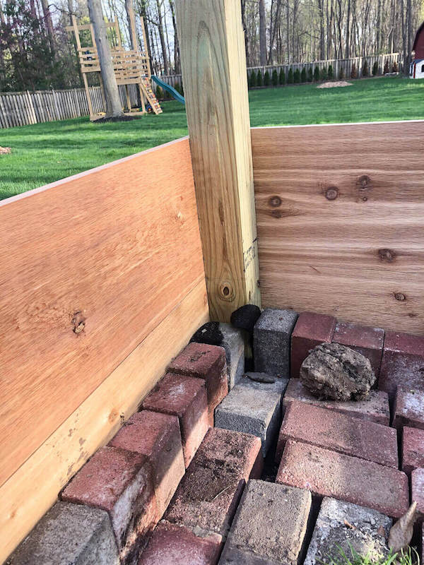 bricks in garden boxes to support the bottom