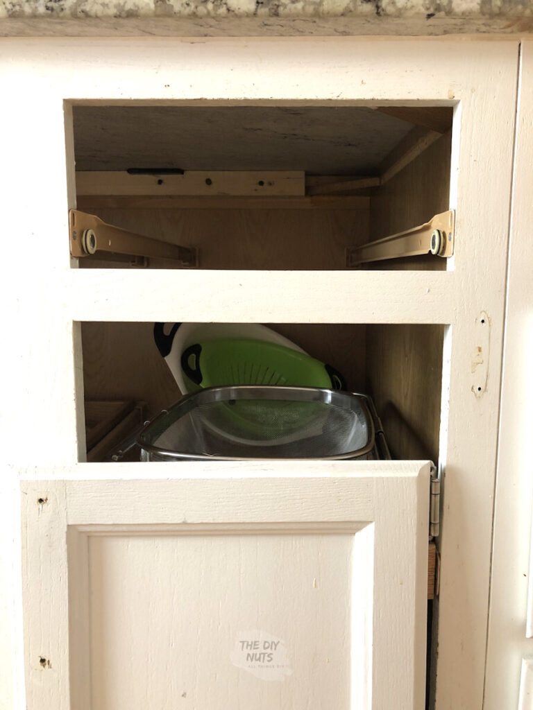 White painted cabinet door off Merlatt