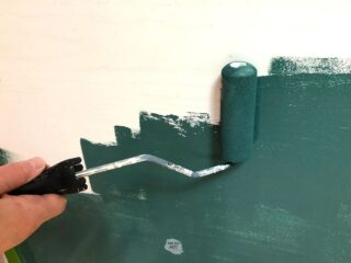 green paint on roller painting kitchen cabinets