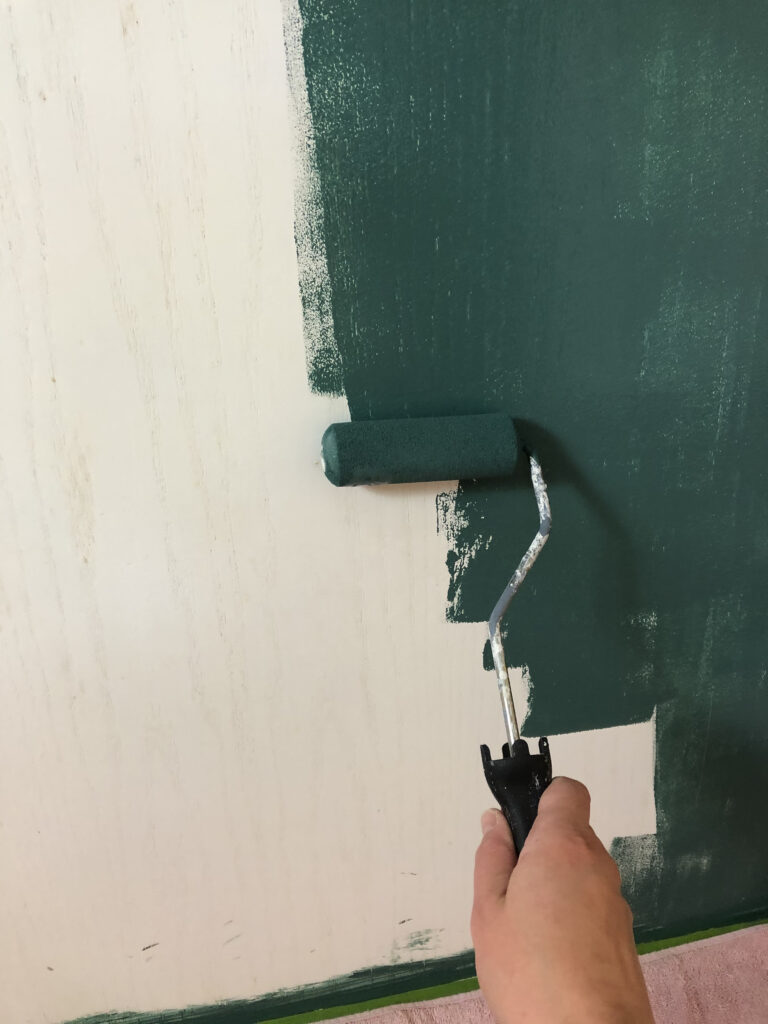 Small foam roller repainting white painted oak kitchen cabinets