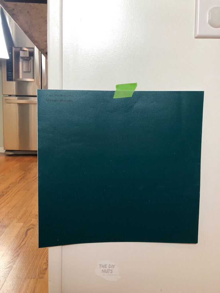 Teal Samplize paint sample with painter's tape on cabinet