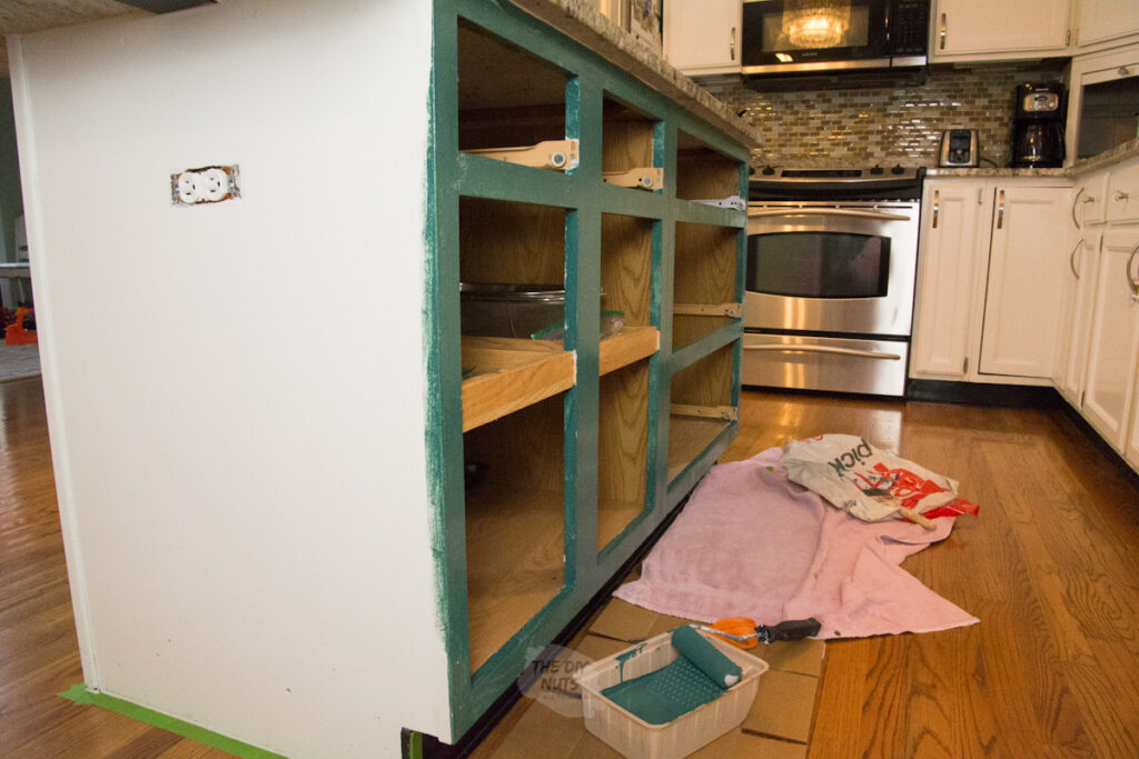 kitchen island cabinets being painted green