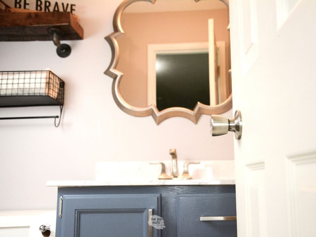 Behr charcoal blue painted bathroom vanity cabinets with sliver mirro