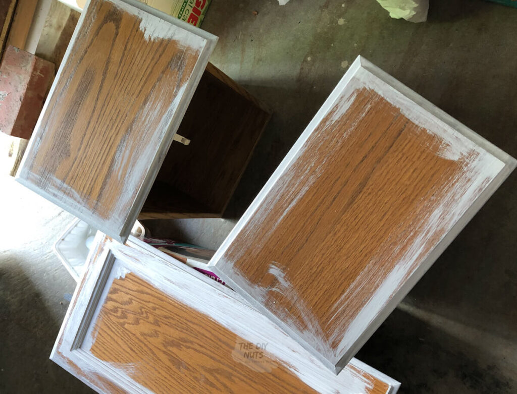 cabinet doors being primed before painting