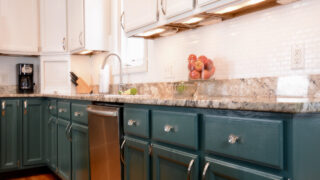 DIY green painted cabinets with upper white painted cabinets