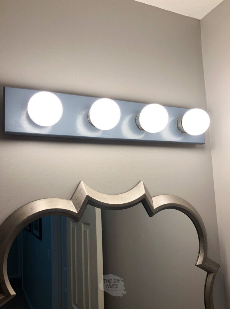 behr charcoal blue painted light with SW grayish walls and silver mirror