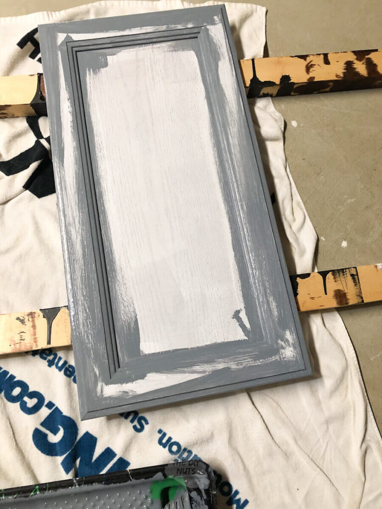 painting creases of cabinet door first with brush on cabinet door