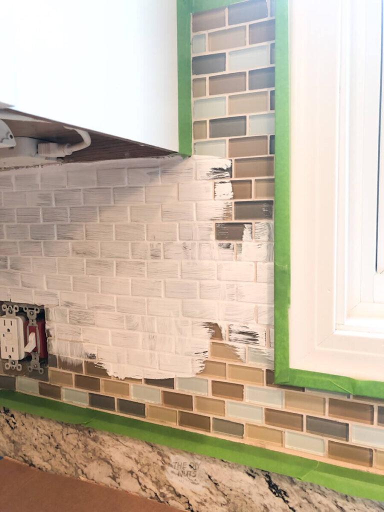 tile backsplash being painted white
