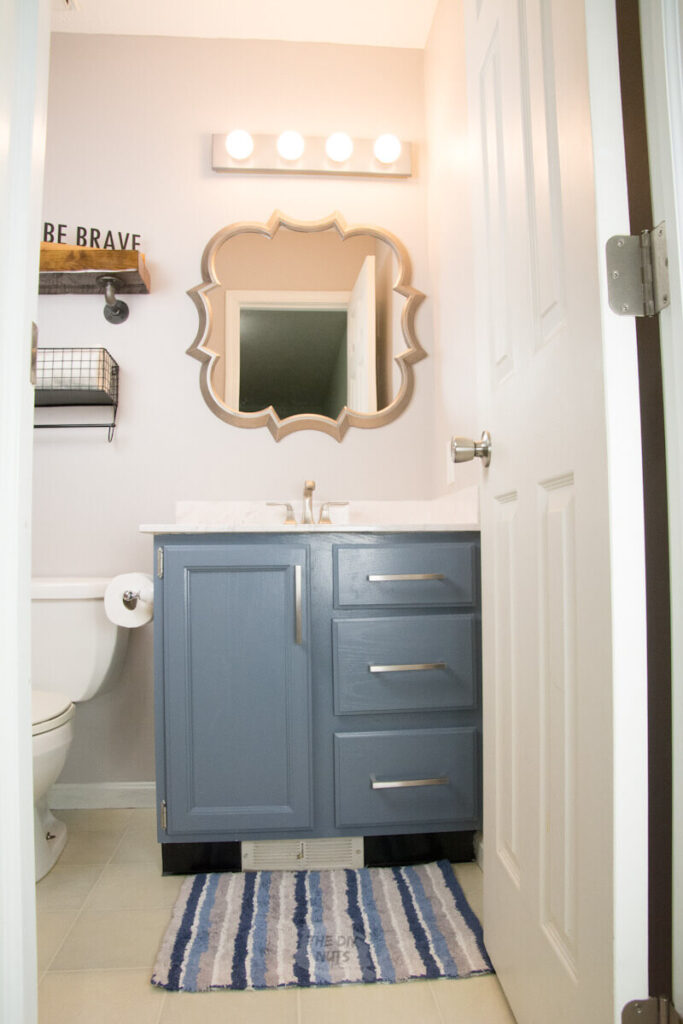 blue gray bathroom painted cabinets in cheap bathroom makeover