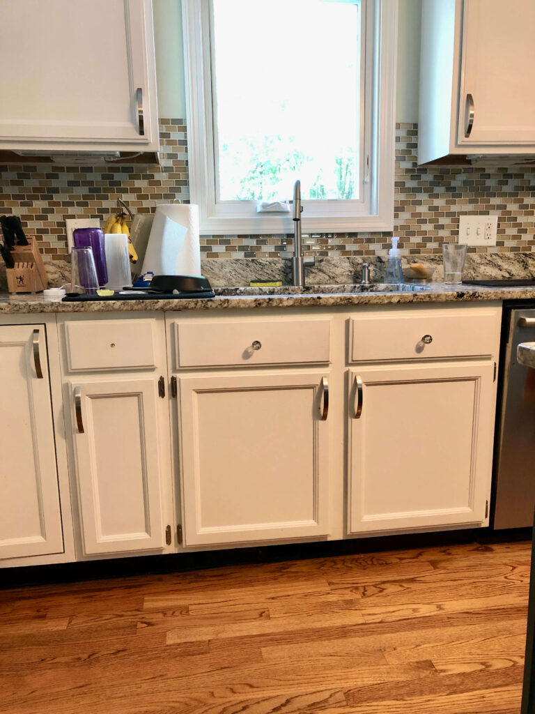old white kitchen cabinets painted with glass backsplash