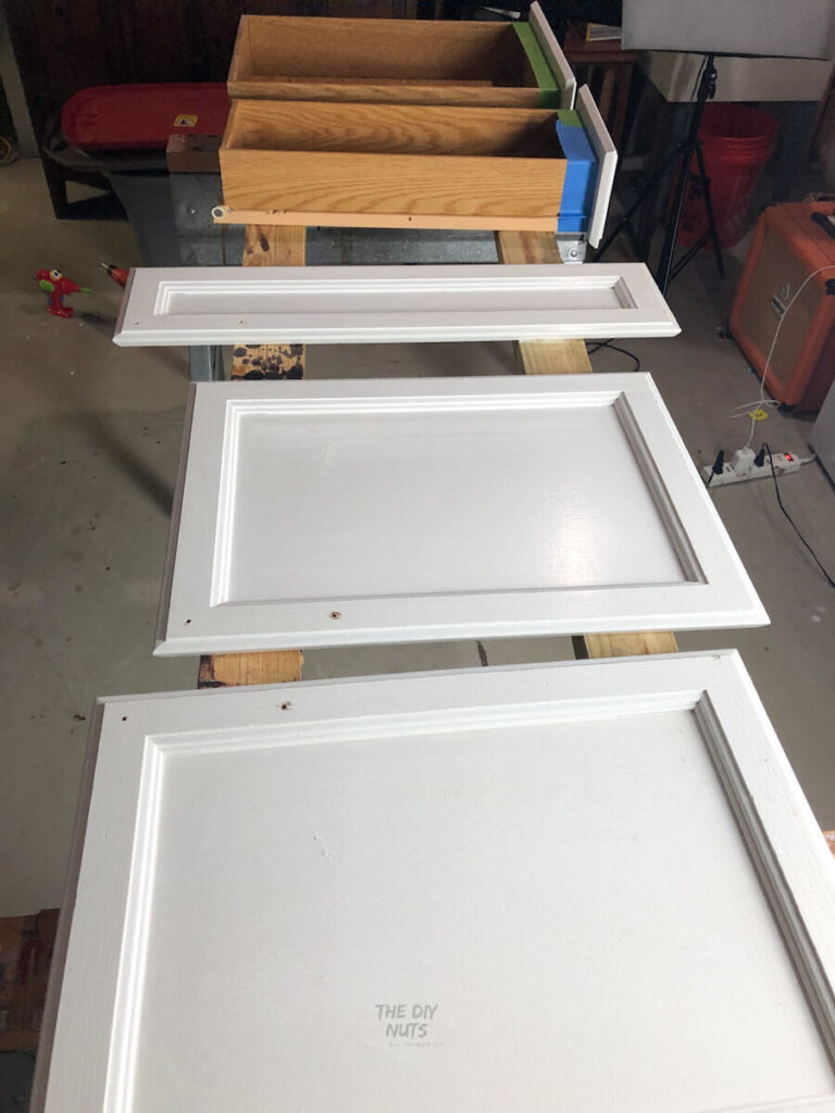 painting cabinet doors on 2 x 4's and sawhorses