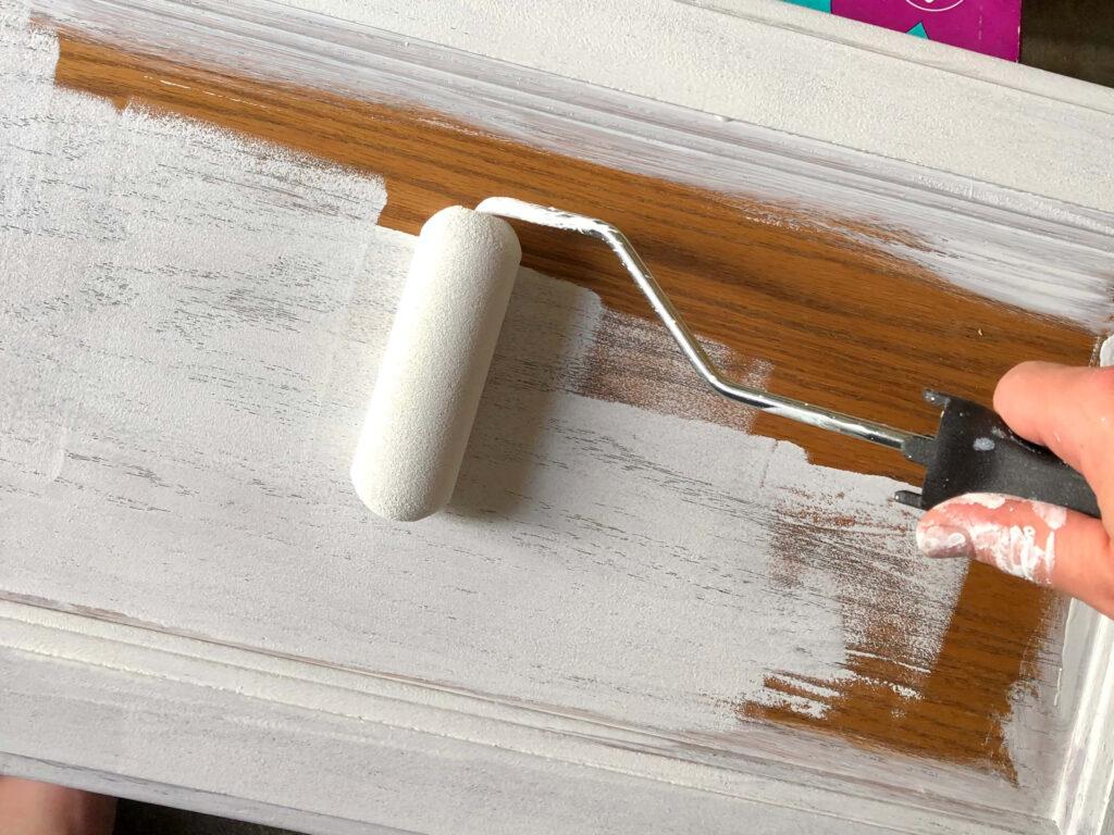 small foam roller painting cabinet door