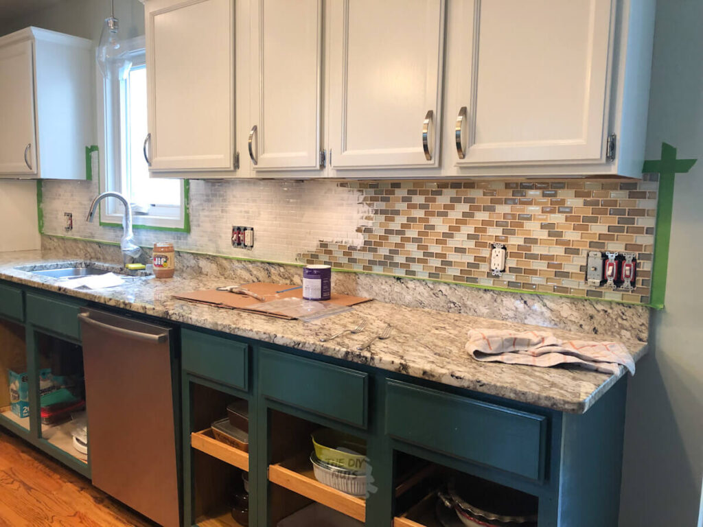 glass tile getting painted white in kitchen remodel