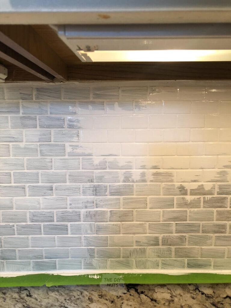 white latex enamel painted on top of primer on backsplash tile