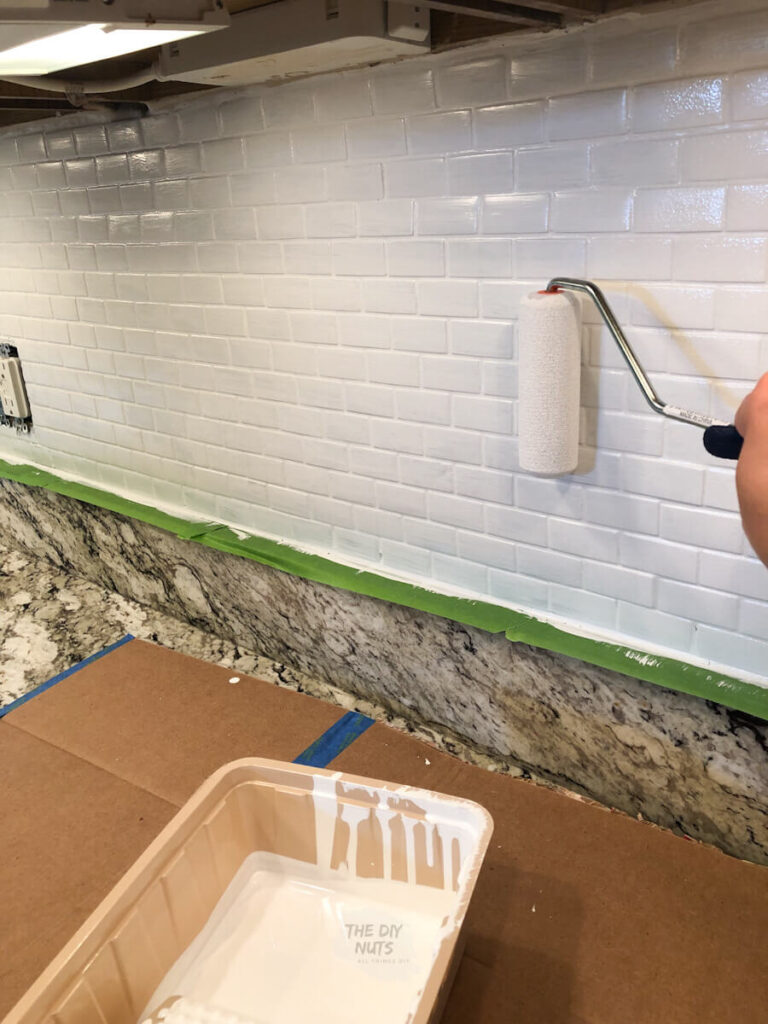 small foam roller painting kitchen backsplash