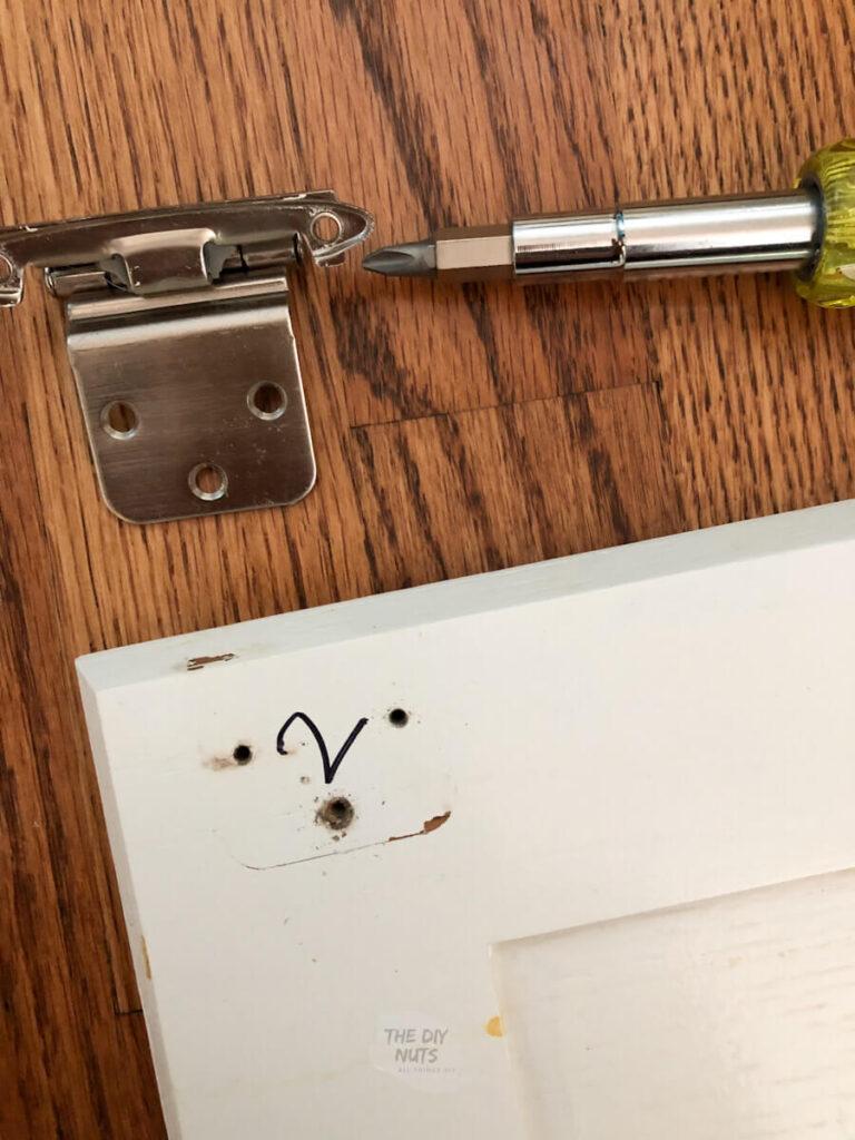 taking cabinet door hardware off