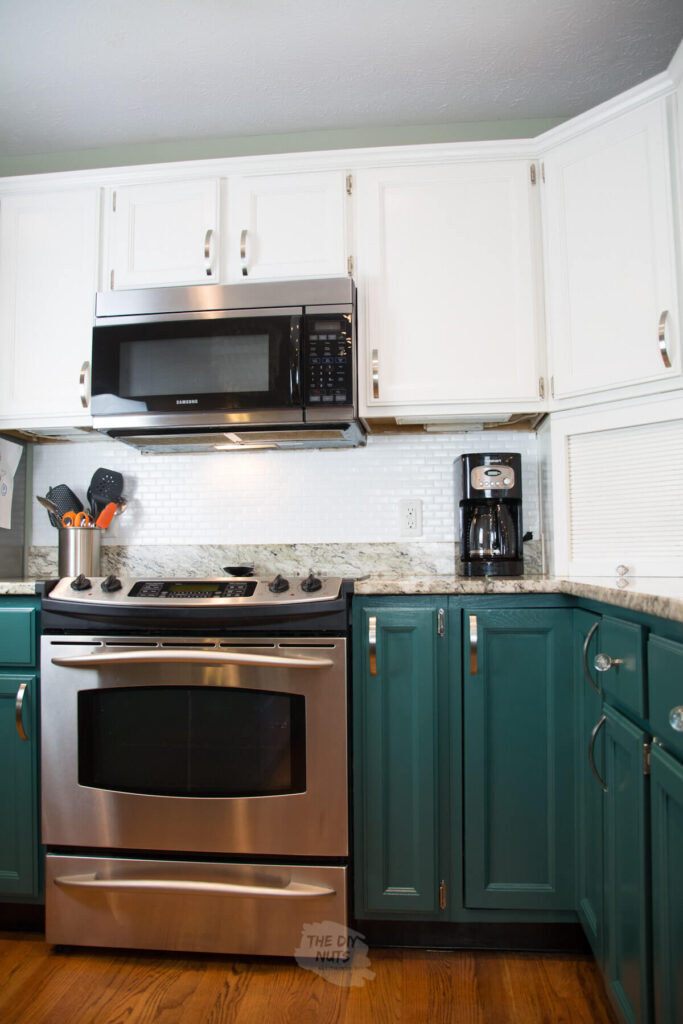 SW rookwood sash green painted lower cabinets and white upper cabinets in kitchen makeover