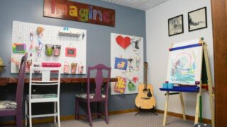 basement room turned into homeschool and craft room for children