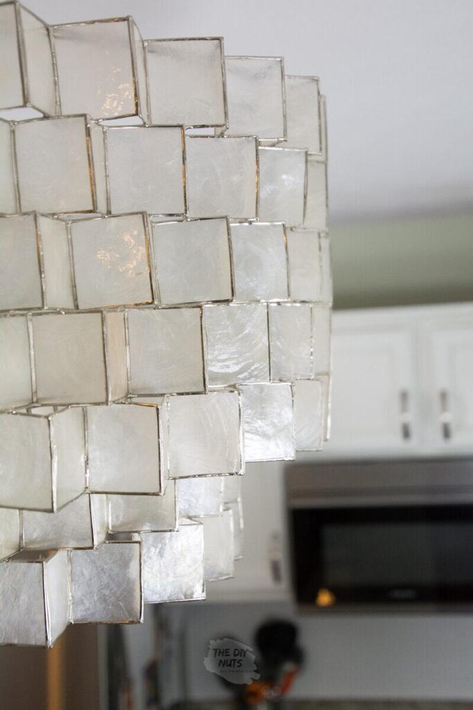 West Elm capiz shell chandelier in kitchen