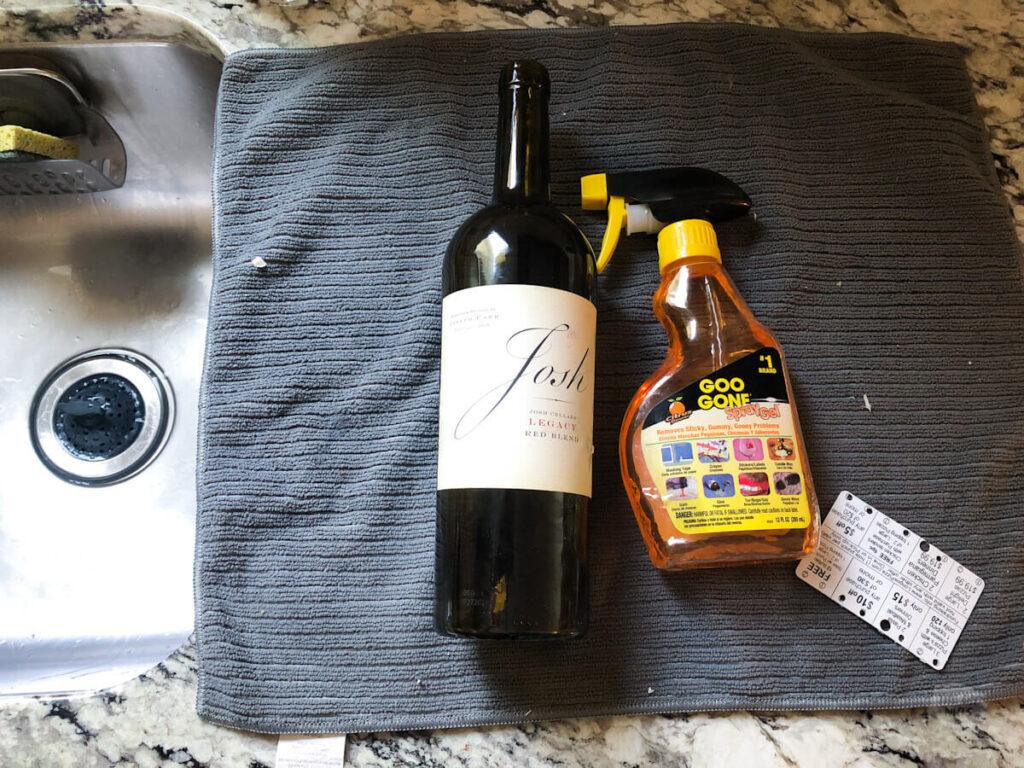 Goo gone next to wine bottle to help remove sticker