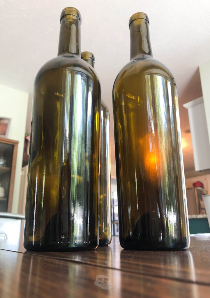 3 wine bottles without labels on table