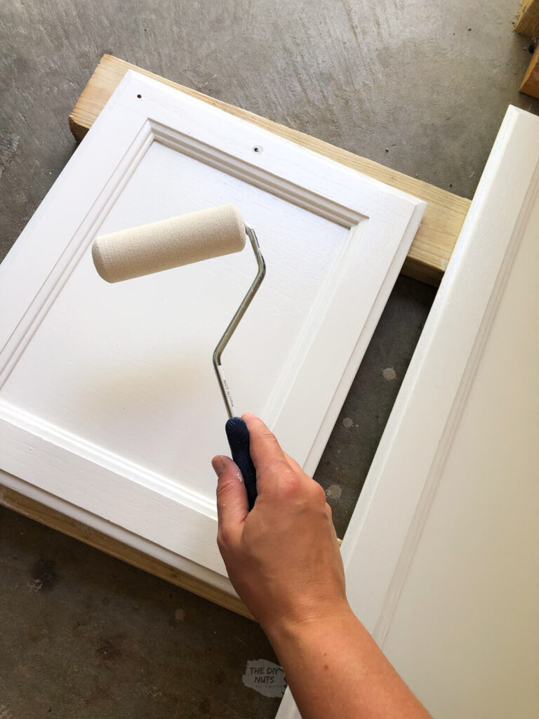 foam roller painting white on kitchen cabinets