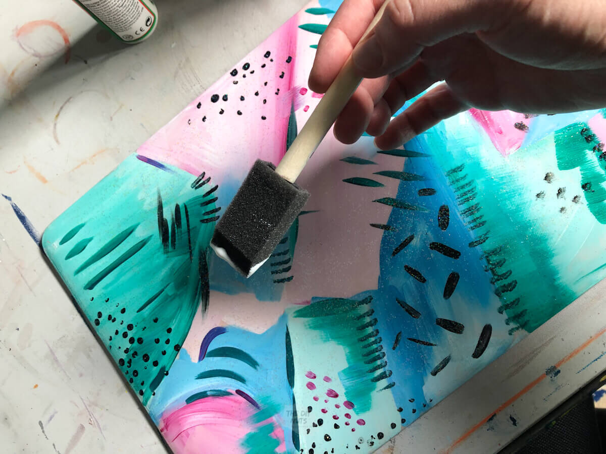 foam brush applying sparkle mod podge